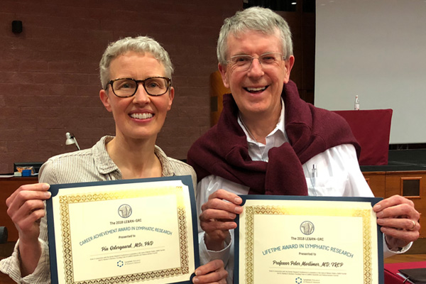 Dr. Peter Mortimer and Dr. Pia Ostergaard presented with LE&RN-GRC Leadership Awards
